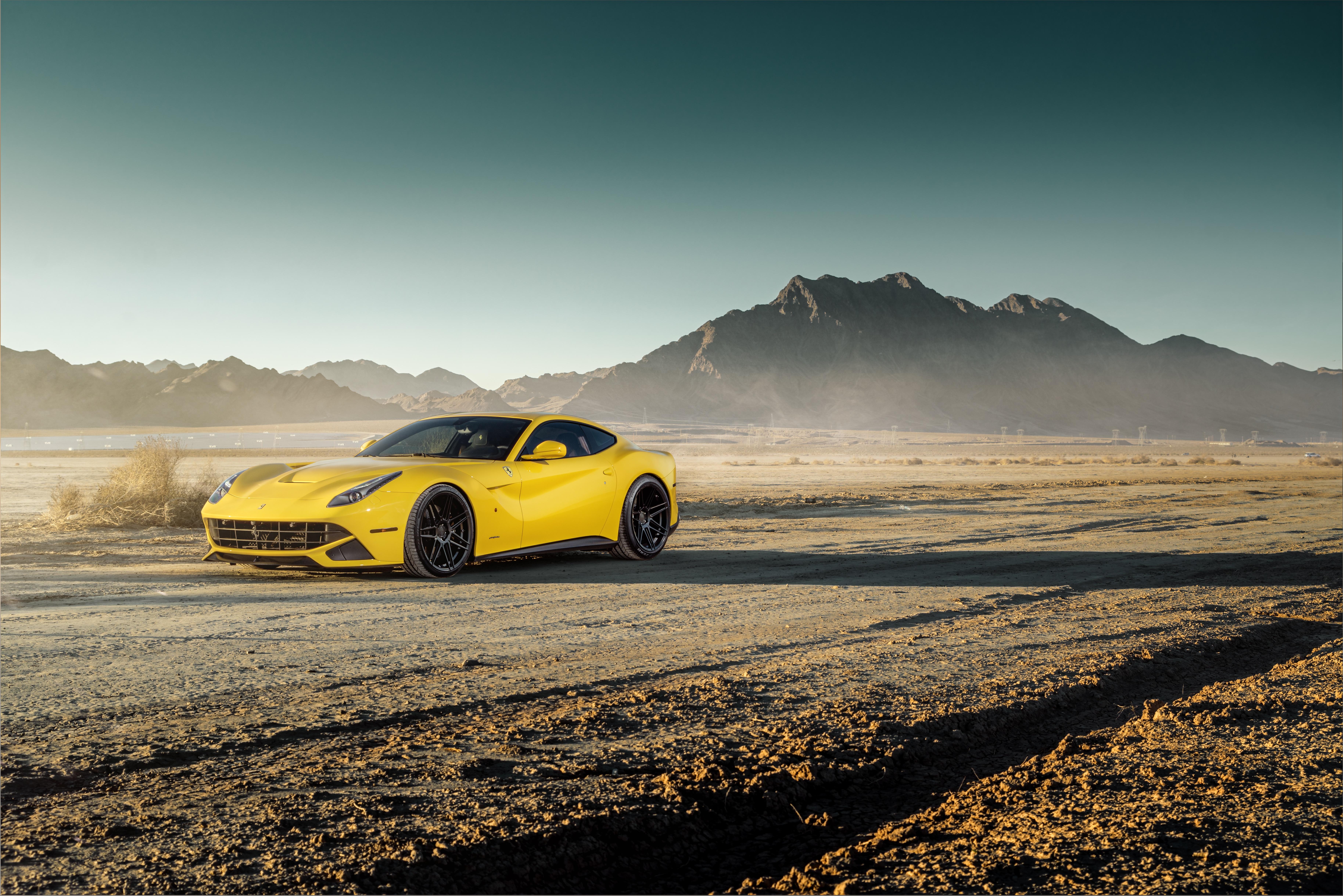 желтый спортивный автомобиль Ferrari F12 Berlinetta Wheelsandmore  № 1564384  скачать