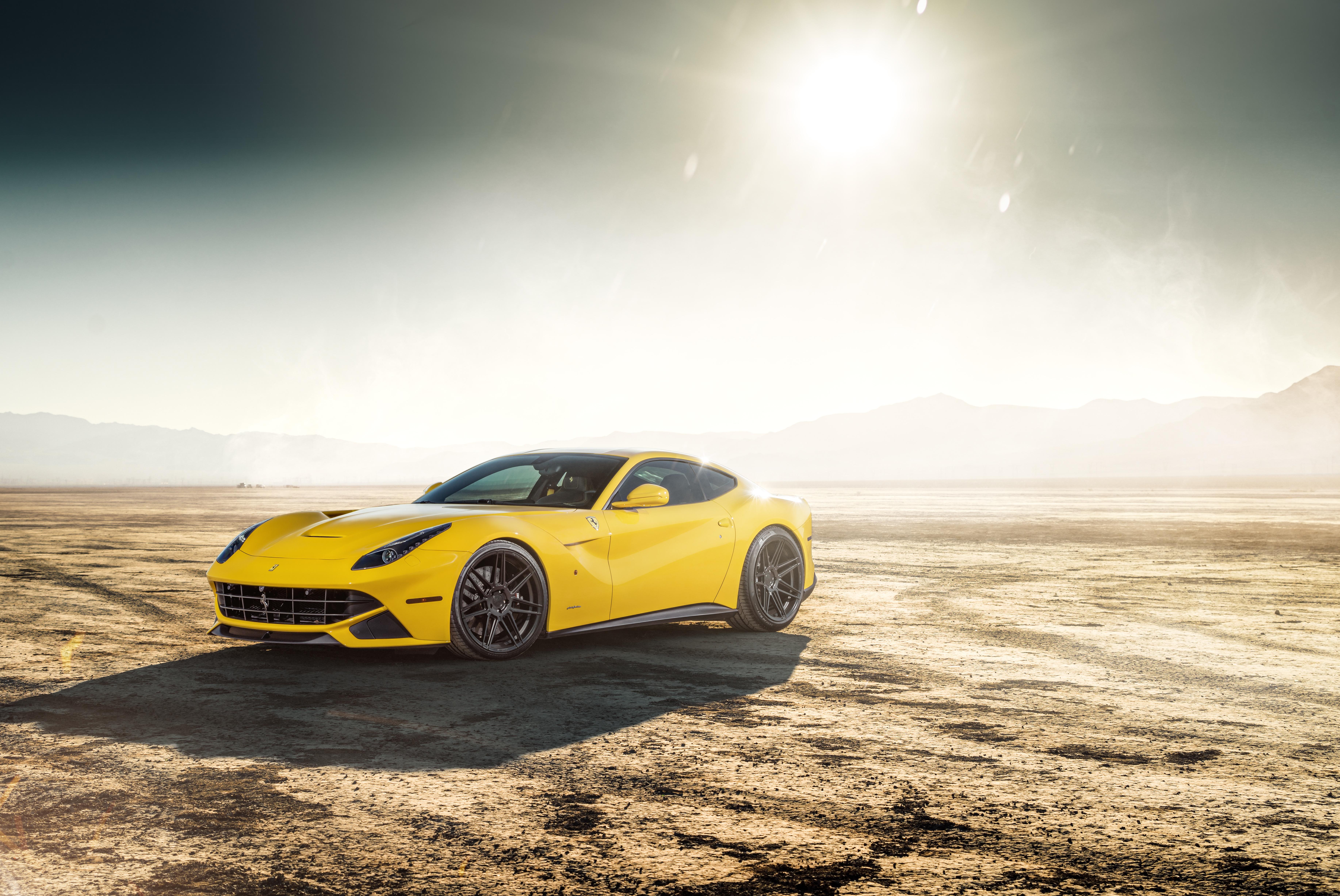 желтый спортивный автомобиль Ferrari F12 Berlinetta Wheelsandmore  № 1564304 загрузить