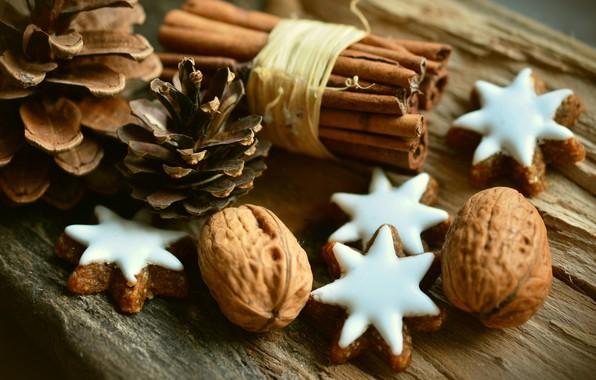 Картинка печенье, звёздочки, корица, шишки, грецкие орехи