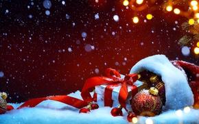 Обои снег, украшения, праздник, подарок, шапка, шар, ель