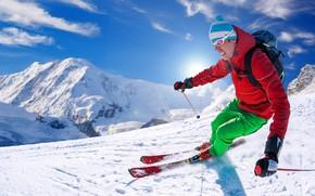 Картинка зима, небо, солнце, снег, горы, спуск, спорт, шапка, лыжи, палки, склон, очки, куртка, костюм, перчатки, …