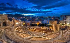 Картинка облака, ночь, огни, дома, руины, Испания, Картахена, римский театр