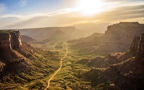 Обои дорога, небо, солнце, камни, скалы, рассвет, долина, США, Mesa Arch, Canyonlands National Park