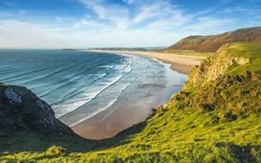 Обои море, зелень, пляж, небо, трава, солнце, облака, горы, скалы, побережье, Англия, Wales